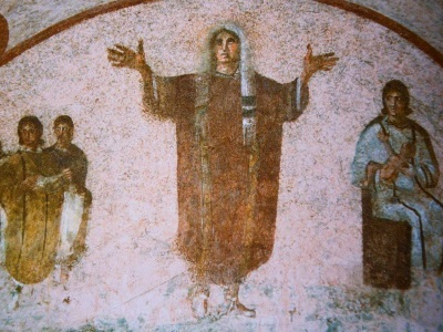 painting from catacombs of a woman praying